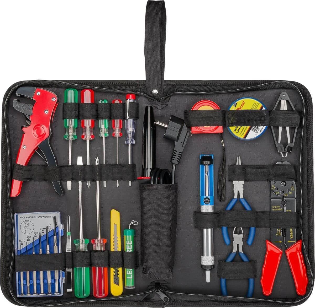 Elektro værktøjssæt med loddekolbe, loddetin, tinsuger og en række andet håndværktøj. Pakket i praktsik etui.